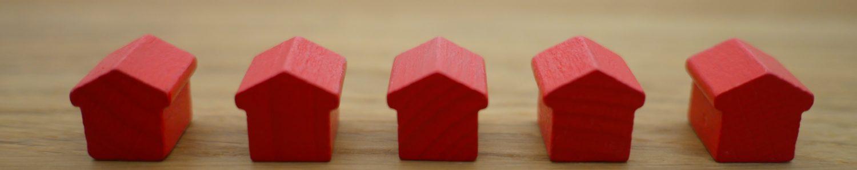 Ein Vergleich von mehreren Möglichkeiten, in Immobilien zu investieren.